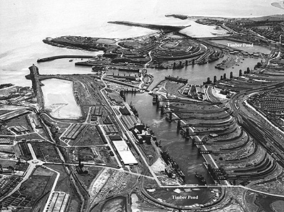 Aerial view of Barry Docks, showing timber ponds. Note the camouflaging on many dock buildings. This photo was taken during or shortly after the Second World War. (Photo - Courtesy of M. Adams)