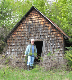 James Stone in the door of the old milk house. Built over an ice-cold mountain spring fed stream, the milk house played a critical role in preserving food. (Photo - Gordon Rainey)