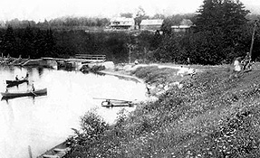 The original dam above Mason Falls, built c.1921. The old Mason homestead can be seen in the background, not far from where the Heather Lodge was built in 1939. (Photo - Rawdon Historical Society)
